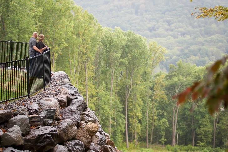 Couple on balcony overlooking mountains