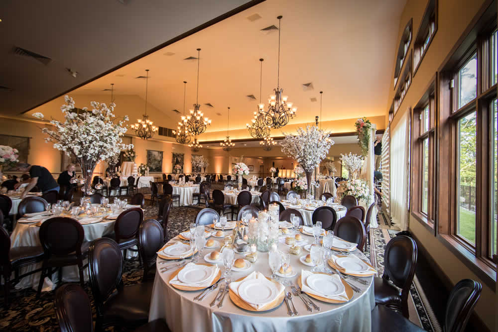Large reception ballroom with beautiful table settings