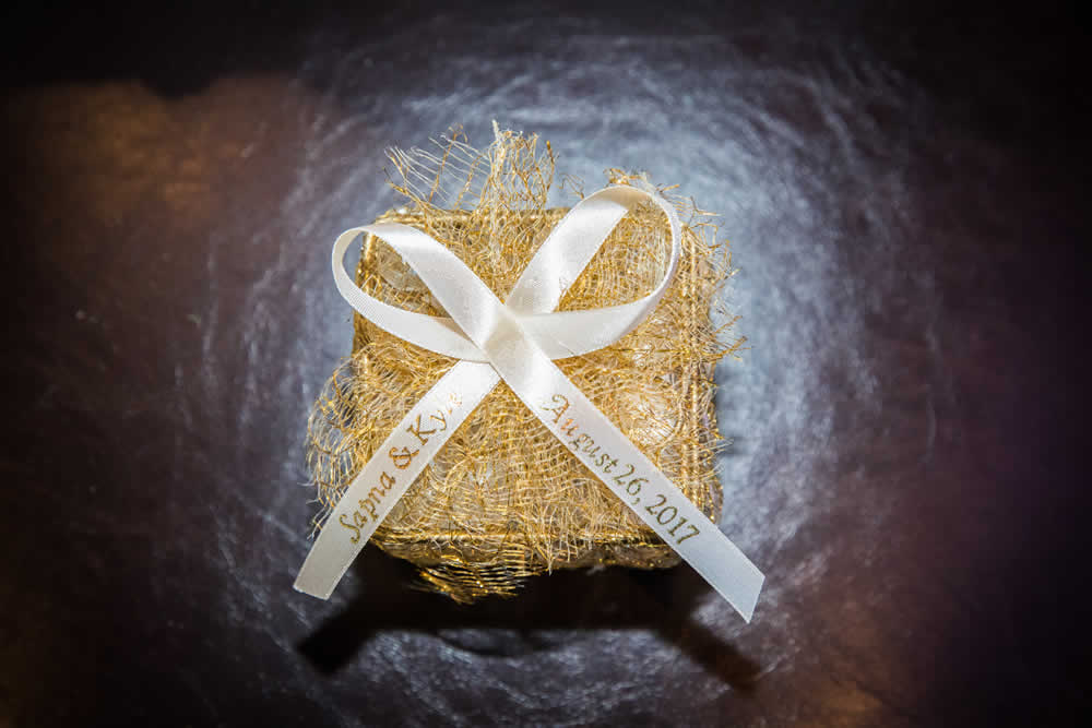 Golden wedding gift with white ribbon