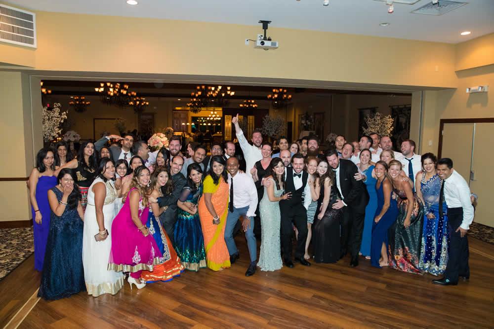 Happy group shot with wedding couple