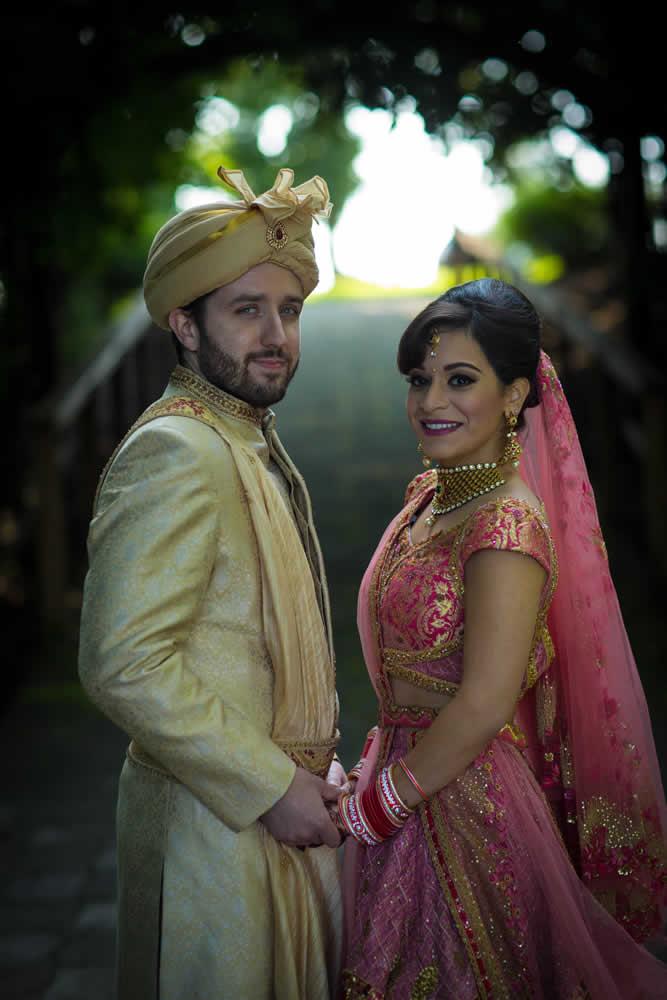 Wedding couple posing in full Indian Wedding attire