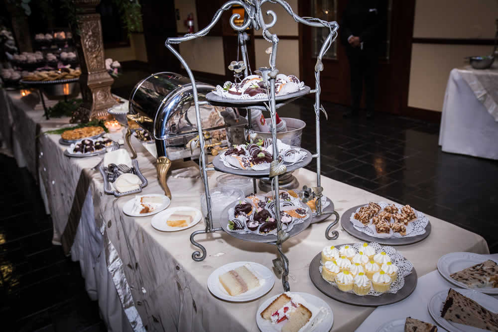 Dessert table with cake and pastries