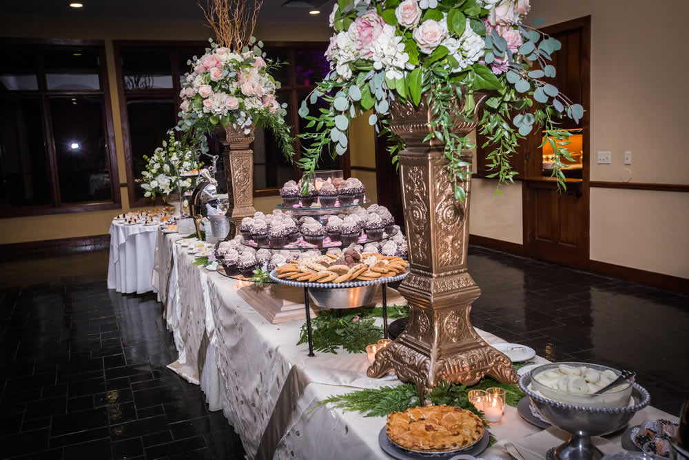 Dessert table with cake, pastries, cookies and pie