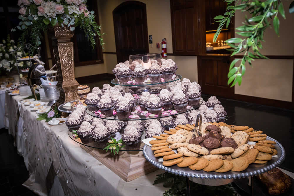 Dessert table with cookies and cupcakes