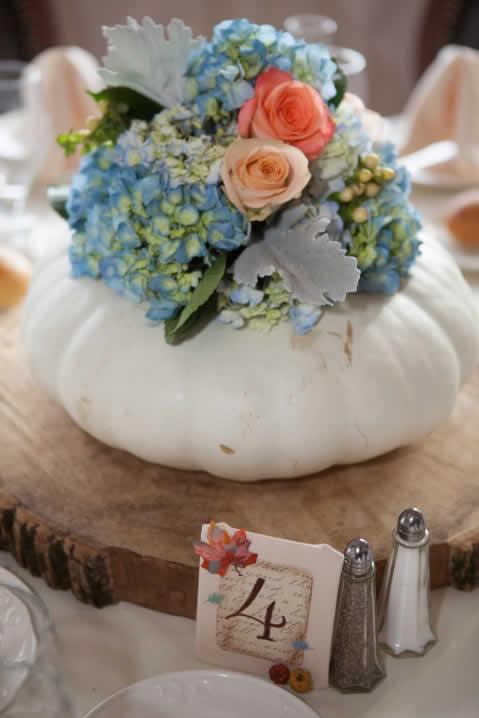 White pumpkin centerpiece with flowers
