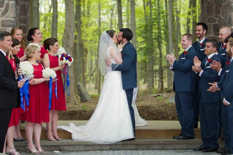 Red, White and Blue Themed Wedding - Couple Kissing