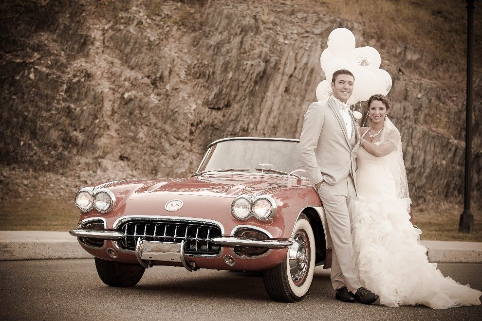 Couple posing with sports car