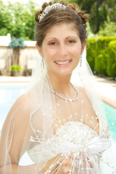 Bride smiling in her veil