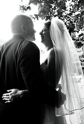Wedding couple gazing into each other's eyes