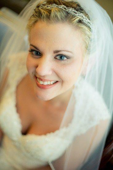 Bride posing in her veil