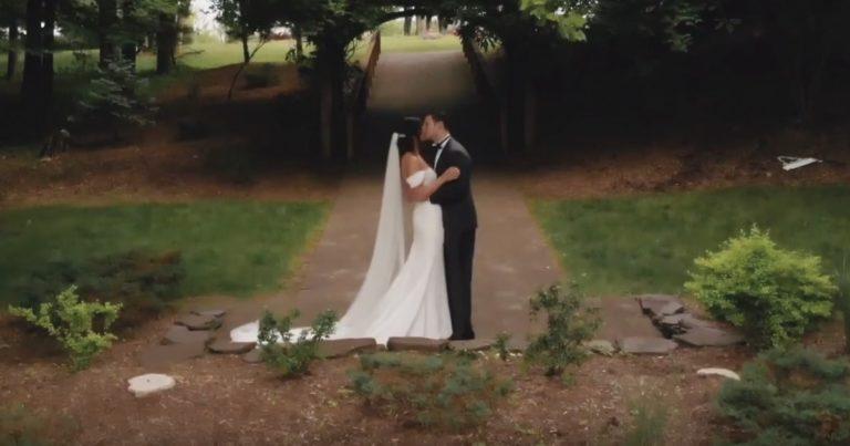 Wedding couple embracing - outdoor wedding