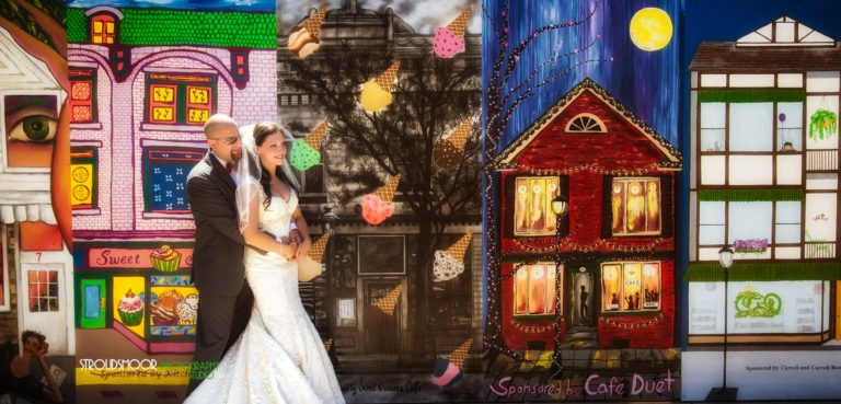 Wedding couple in front of beautiful mural