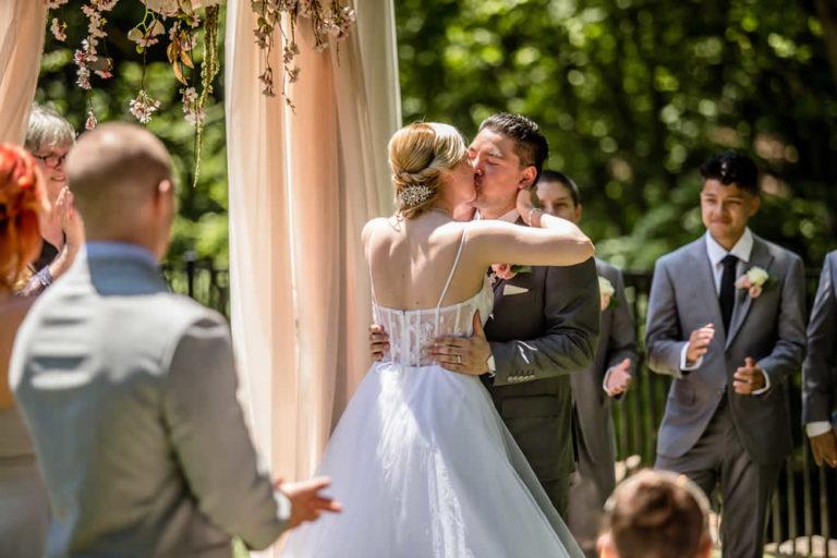 Wedding ceremony - kiss - outdoor wedding - Pocono wedding