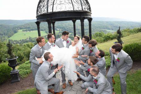 Groomsmen holding up the bride at Ridgecrest wedding venue