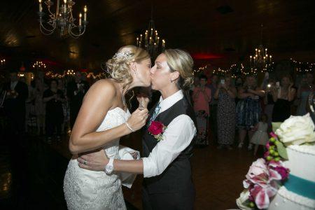 Wedding couple sharing a kiss LGBTQ