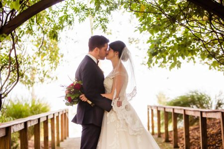 Wedding couple share kiss