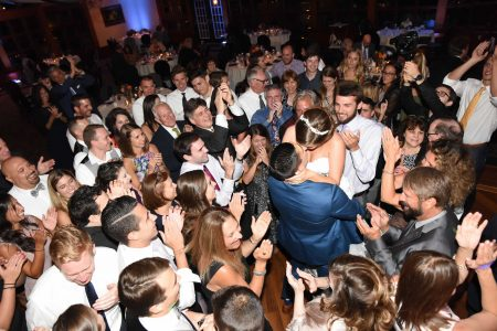 Wedding couple kissing and dancing at reception