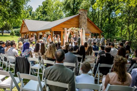 Family and friends watch wedding couple