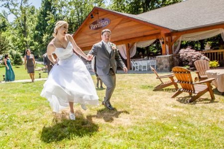 Bride and groom outside pavilion